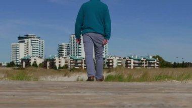 Man walking  to town — Stok video