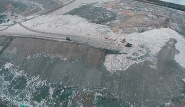 Aerial Shot Landfill with Working Trucks and Tractor, top view — Stock Video