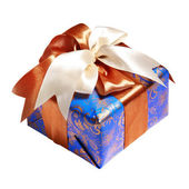 Blue gift packing tied by ribbon — Stock Photo