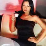 Brunette drinks coffee — Stock Photo #56848123