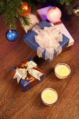 Christmas boxes with two candle — Stock Photo