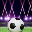 Soccerball in festive lighting — Stockfoto #64516517