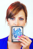 Woman holds digital device — Stock Photo