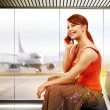 Happy woman in airport — Stock Photo #70218627