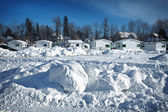 Fishing huts in snow — Stock Photo