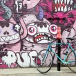 Parked bike and graffiti — Stock Photo #71421827