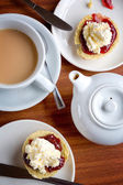 Tea of scones with clotted cream and jam — Stock Photo