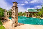 Tropical holidays at the swimming pool — Stockfoto