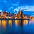 Gdansk at night with reflection in Motlawa river — Stock Photo #52675733