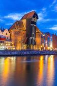 Medieval port crane over Motlawa river at night — Stock Photo