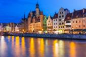 Old town of Gdansk at night with reflection in Motlawa river — Stock Photo