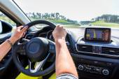 Driving a car with navigation — Stock fotografie