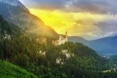 Neuschwanstein Castle in Bavarian Alps at sunset — ストック写真