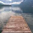 Jetty on the misty lake in Alps — Stock Photo #54442653