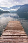 Jetty on the misty lake in Alps — Photo