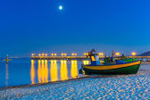 Baltic beach with fishing boat at night — Stock Photo