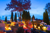 Cemetary at night with colorful candles for All Saints Day — Stock Photo