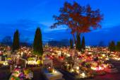 Cemetary at night with colorful candles for All Saints Day — Stockfoto