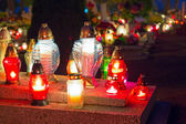Colorful candles on the cemetery at All Saints Day — Stock Photo