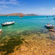 Fishing boats on the blue lagoon of Crete — Stock Photo #58878683