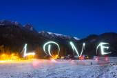 Love sign under Tatra mountains at night — Stock Photo