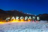 Christmas sign under Tatra mountains at night, Poland — Stock Photo