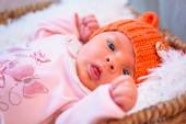 Newborn baby girl in hat — Stock Photo