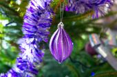 Beautiful purple and silver baubles — Stock Photo