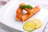 Salmon steak with lemon and lime — Stock Photo