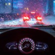 Driving a car in snowy weather — Stock Photo #62046107