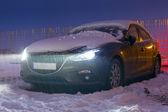 Car under heavy overnight snowfall — Stock Photo