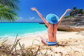Woman in hat enjoying sun holidays on the beach — Stock Photo