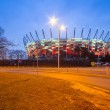 National Stadium in Warsaw illuminated at night by national colors, Poland — Stock Photo #67304213
