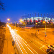 National Stadium in Warsaw illuminated at night by national colors, Poland — Stock Photo #67304251