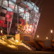 National Stadium in Warsaw illuminated at night by national colors, Poland — Stock Photo #67304275
