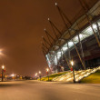 National Stadium in Warsaw illuminated at night by national colors, Poland — Stock Photo #67304337