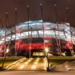 National Stadium in Warsaw illuminated at night by national colors, Poland — Stock Photo #67304421