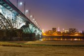 Poniatowski bridge over Vistula river illuminated at night, Warsaw — Stock Photo