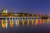 Panorama of Warsaw at night with reflection in Vistula river — Photo