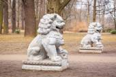 Chinese stone statues in the Royal Bath park — Stock Photo