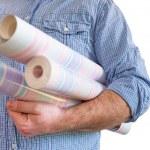 Handyman carrying rolls of wallpaper — Stock Photo #70447069