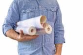 Handyman carrying rolls of wallpaper — Stock fotografie