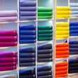 Colorful sweaters on the shop shelves — Stock Photo #70716969