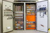 Electricity distribution box with wires, circuit breakers and fu — Stock Photo
