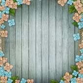 Blue wooden background with  flowers, pearls and lace — Stock Photo