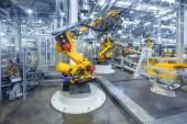 Robots in a car plant — Stock Photo