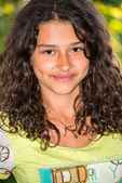 Young pretty girl with a curly hair outdoors — Stok fotoğraf