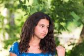 Beautiful girl in a park on summer day — Stock Photo