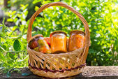 Canned vegetables homemade in wicker basket — Stock Photo