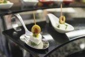 Canapes cheese olives on a white plate — Foto Stock